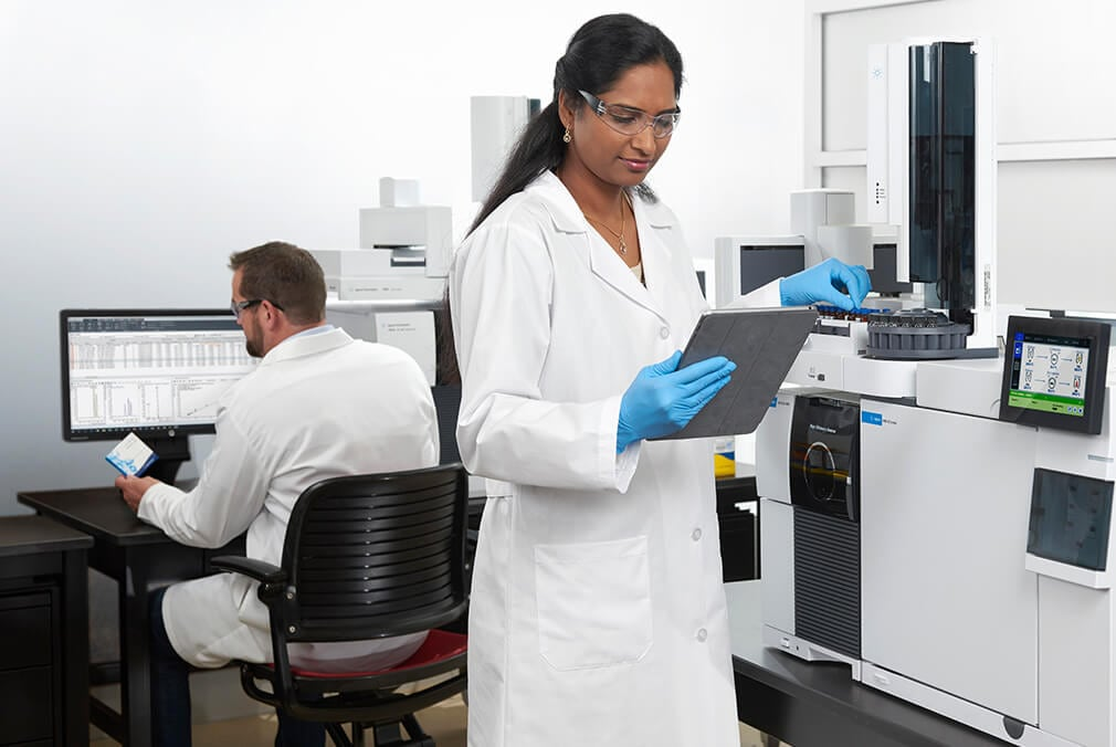 Scientist working with the Agilent 8890 GC system